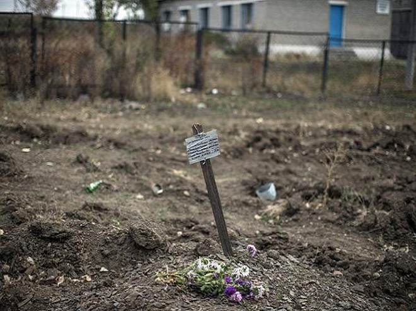 Chấn động: Nội tạng một số nạn nhân trong mộ tập thể ở Donetsk biến mất ảnh 2