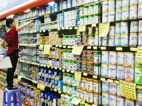 Bộ Tài chính đề nghị doanh nghiệp giảm giá bán sữa ảnh 1
