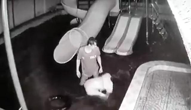 Hình ảnh cắt từ clip cho thấy chị M. bị chồng đánh đập dã man