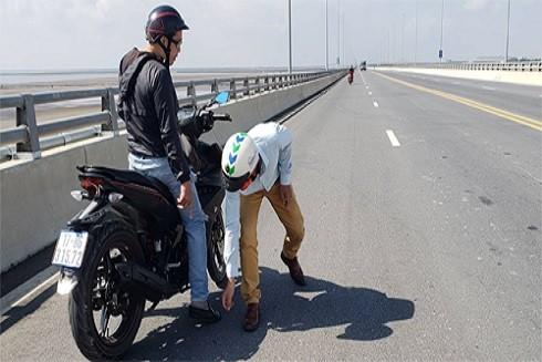 Hành vi rải đinh trên đường lộ bị xử lý thế nào ảnh 1