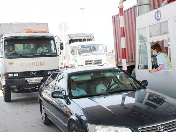 Thu phí tự động không dừng trên QL1 và đường Hồ Chí Minh ảnh 1