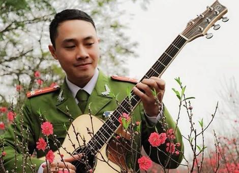Lớp học guitar cho trẻ em khiếm thị của một Thượng úy trẻ ảnh 1