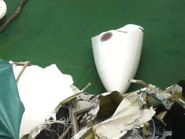 Mảnh vỡ được xác định là của chiếc máy bay CASA-212 (Ảnh: QĐND)