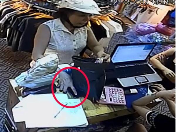 Hình ảnh về người phụ nữ trộm chiếc Iphone 5 của nhân viện được camera ghi lại