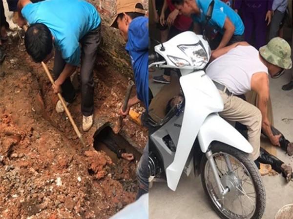 Người dân và cơ quan chức năng cứu nam thanh niên mắc trong cống đưa đi cấp cứu