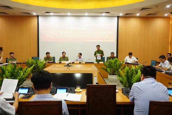 Đại tá Trần Ngọc Dương, Phó Giám đốc CATP Hà Nội báo cáo tại Hội nghị