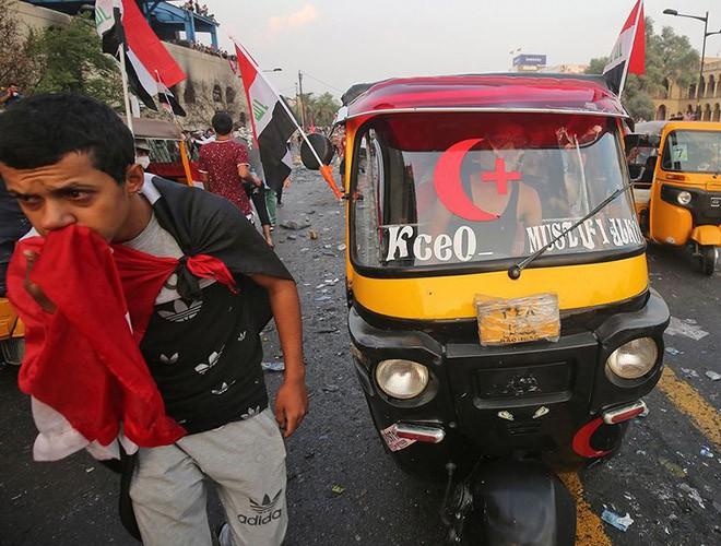 """Phong trào biểu tình mang tên """"cách mạng tuk tuk"""" ở Iraq ảnh 8"""