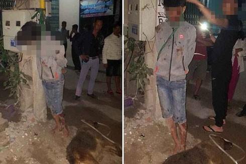 Nam thanh niên trộm chó bị người dân vây đánh.
