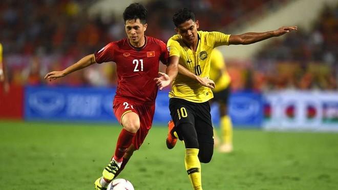 ĐT Việt Nam (trái) đang có chút lợi thế trước chung kết lượt về (Ảnh: Getty)
