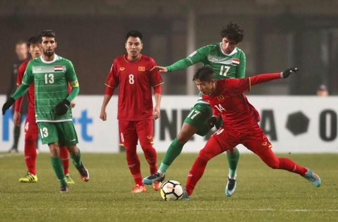 U23 Việt Nam (áo đỏ) đã phải chơi với hơn 100% sức lực trong trận thắng lịch sử với U23 Iraq kéo dài hơn 120 phút