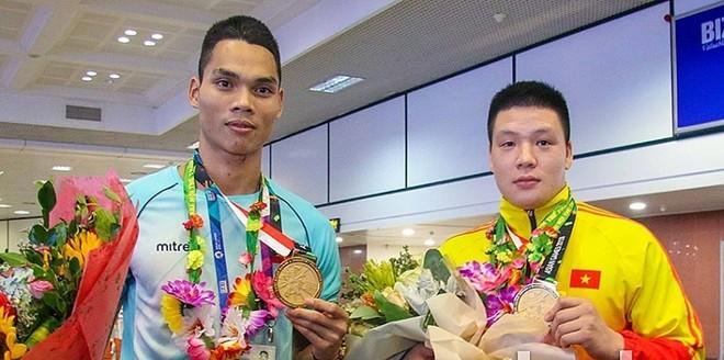 Hai nhà vô địch pencak silat Nguyễn Văn Trí (phải) và Trần Đình Nam