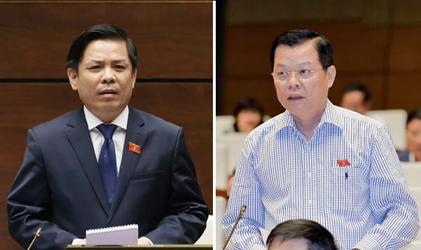 Bộ trưởng Nguyễn Văn Thể (bên trái) trả lời chất vấn của đại biểu Đào Thanh Hải