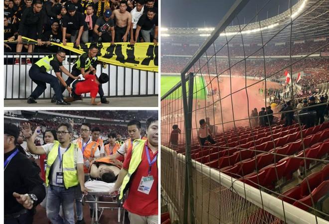 """""""Chảo lửa"""" Bung Karno xảy ra vụ ẩu đả xuất phát từ cổ động viên quá khích Indonesia nhắm vào cổ động viên Malaysia, ở trận đấu hôm 5-9"""