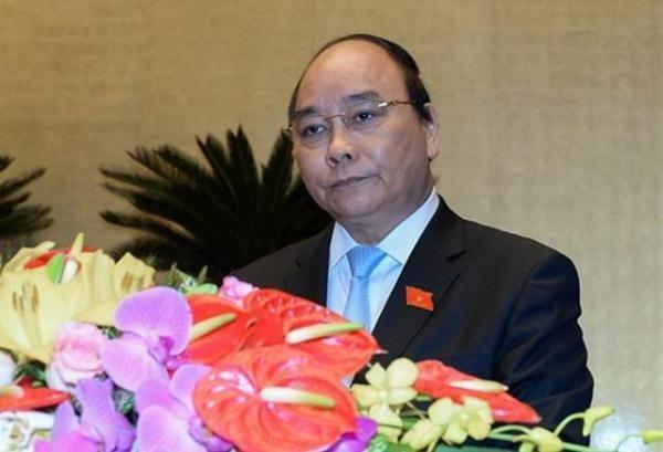 Thủ tướng Chính phủ Nguyễn Xuân Phúc trình bày tờ trình trước Quốc hội