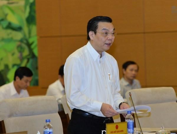 Bộ trưởng Bộ Khoa học và Công nghệ Chu Ngọc Anh báo cáo tại phiên họp