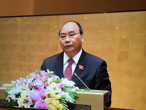 Thủ tướng Chính phủ Nguyễn Xuân Phúc đọc tờ trình trước Quốc hội