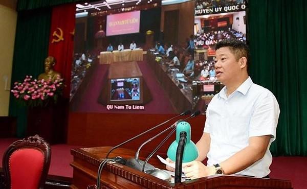 Giám đốc Sở Kế hoạch và Đầu tư Hà Nội Nguyễn Mạnh Quyền báo cáo tại hội nghị