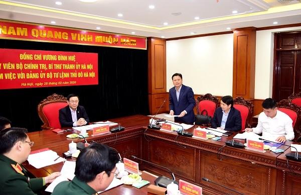 Đồng chí Vũ Đức Bảo công bố các Quyết định của Ban Thường vụ Thành ủy Hà Nội