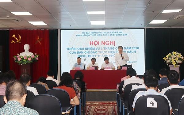 Giám đốc BHXH TP Hà Nội Nguyễn Đức Hòa báo cáo tại hội nghị