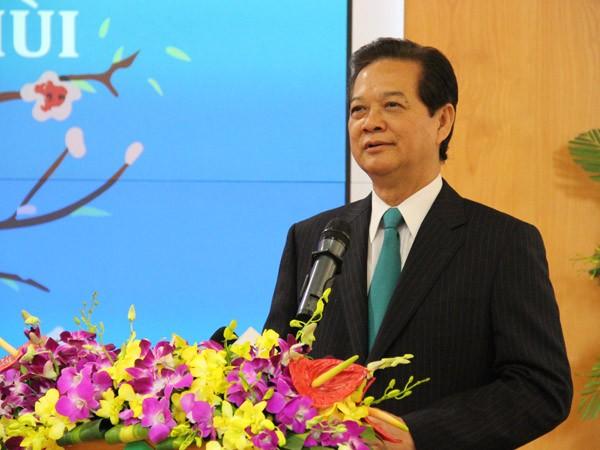 Thủ tướng Nguyễn Tấn Dũng đánh cồng khai trương phiên giao dịch chứng khoán đầu năm Ất Mùi ảnh 2