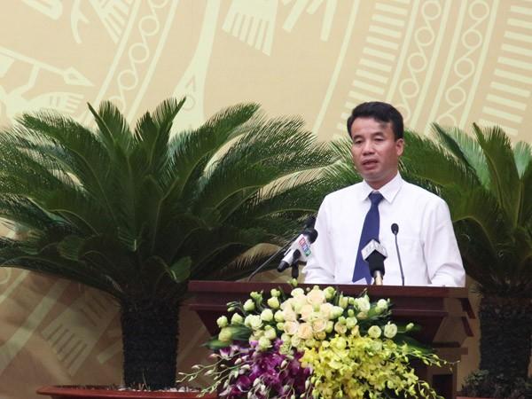 Cục trưởng Cục Thuế TP Hà Nội, Nguyễn Thế Mạnh trả lời đại biểu