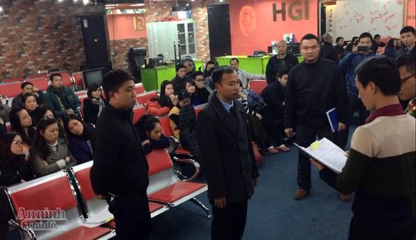 Cơ quan công an đọc lệnh khám xét trụ sở Công ty HGI