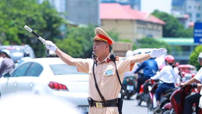 Trường hợp Cảnh sát giao thông được dừng phương tiện để kiểm tra khi xe đang lưu thông trên đường ảnh 1