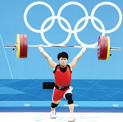 Lực sỹ Việt Nam bất ngờ có huy chương Olympic từ... 8 năm trước ảnh 1
