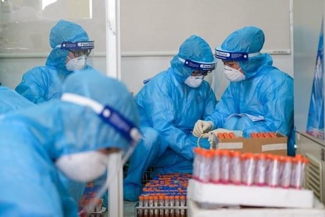 Thêm 2 người ở Hoàng Mai và Thanh Xuân mắc Covid-19, Hà Nội đổi chiến lược xét nghiệm ảnh 1