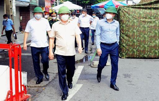 Bí thư Thành ủy Đinh Tiến Dũng: Hà Nội sẽ đẩy lùi dịch bệnh, sớm bắt đầu trạng thái bình thường mới ảnh 1