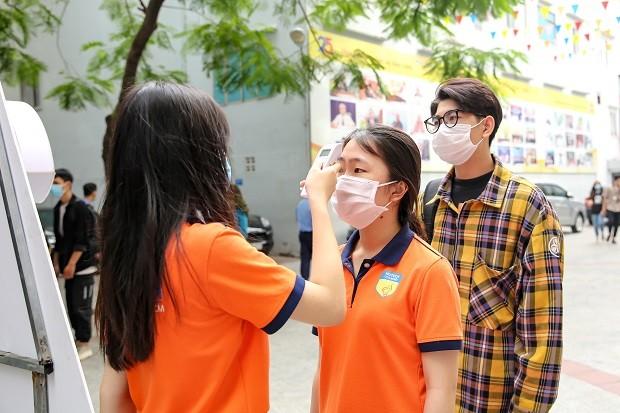[Ảnh] Đón hơn 30.000 sinh viên trở lại sau khi các trường hợp tiếp xúc gần với BN1342 có kết quả âm tính ảnh 3