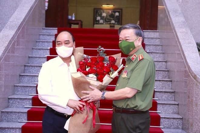 Chủ tịch nước Nguyễn Xuân Phúc dự hội nghị sơ kết công tác Công an 6 tháng đầu năm ảnh 1