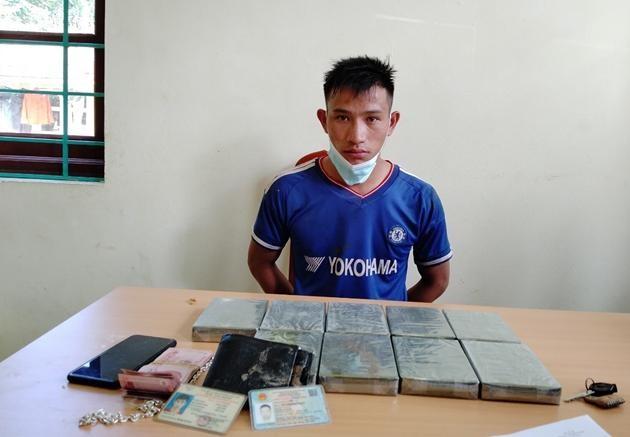 Mang 9 bánh heroin vượt biên giới về Việt Nam tiêu thụ ảnh 1