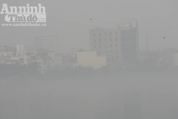 Sương mù dày đặc phủ kín Hà Nội ảnh 17