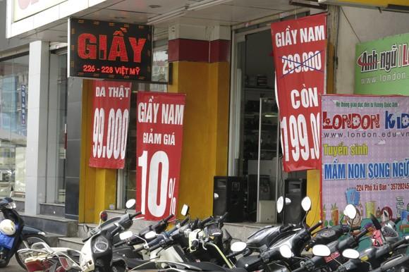 Shop sang trọng đồng loạt đóng cửa vì kinh tế suy thoái ảnh 8