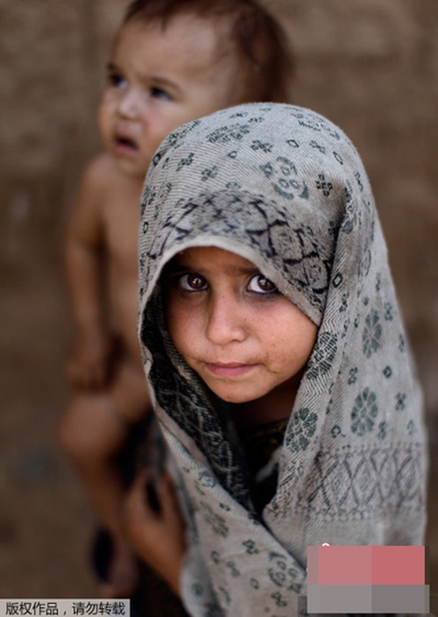 Những bức ảnh ấn tượng về trẻ em năm 2011 ảnh 15