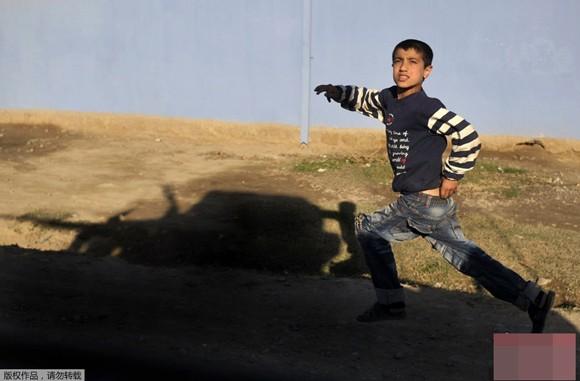 Những bức ảnh ấn tượng về trẻ em năm 2011 ảnh 6