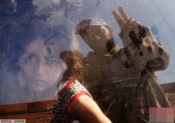 Những bức ảnh ấn tượng về trẻ em năm 2011 ảnh 7