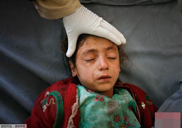 Những bức ảnh ấn tượng về trẻ em năm 2011 ảnh 4