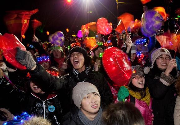 Người dân thế giới đón mừng năm mới 2013 ảnh 16