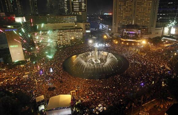 Người dân thế giới đón mừng năm mới 2013 ảnh 11