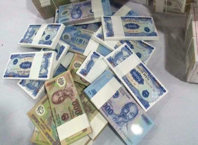 """Đổi tiền lẻ, tiền mới dịp Tết: Thận trọng kẻo """"tiền mất, tật mang"""" ảnh 1"""