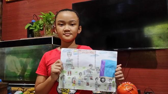 Ngạc nhiên với tài năng của bé gái lớp 3 vẽ tranh cổ động phòng chống dịch Covid-19 ảnh 1
