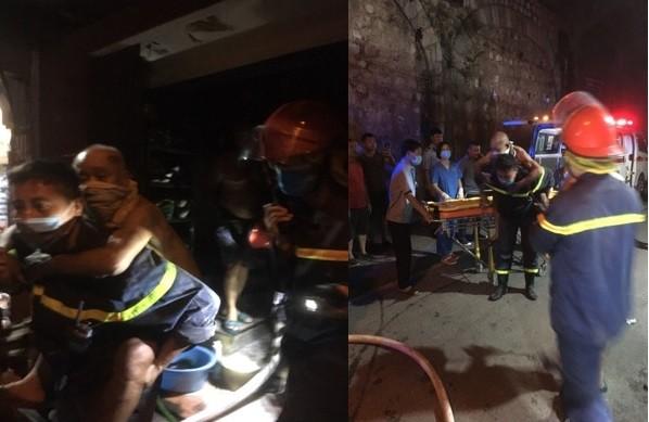 Kịp thời giải cứu 2 người mắc kẹt trong đám cháy ở khu phố cổ ảnh 1