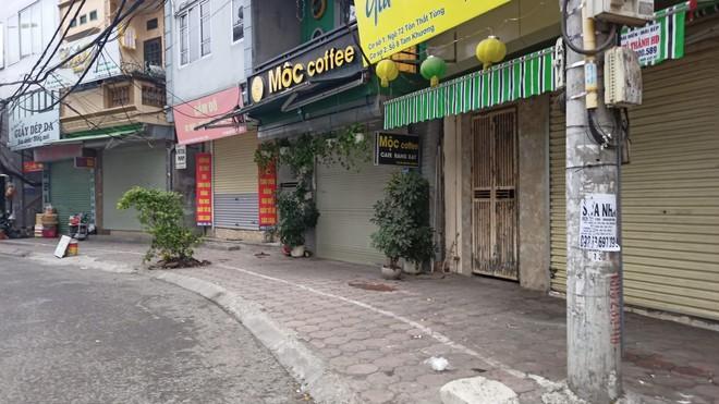 Hà Nội: Lực lượng Công an cơ sở triển khai tuyên truyền, nhắc nhở các hộ kinh doanh chấp hành yêu cầu phòng chống Covid, từ 0h ngày 16-2 ảnh 5