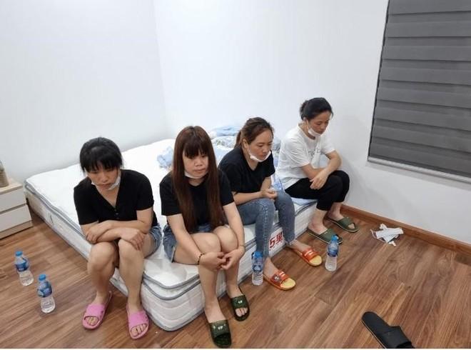 Hà Nội: Nhập cảnh trái phép, 11 người Trung Quốc cố thủ trong căn hộ chung cư ảnh 2