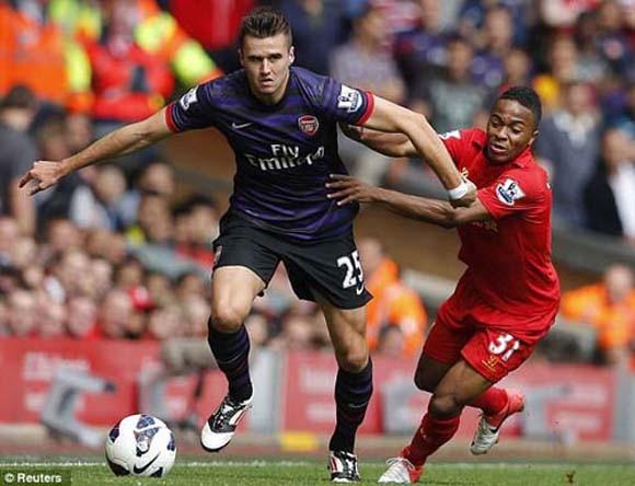 Podolski và Cazorla tỏa sáng, Arsenal hạ Liverpool ảnh 1