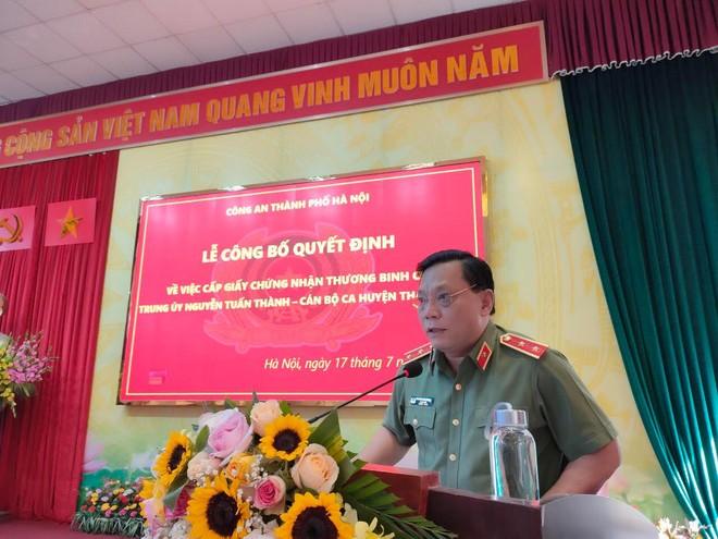 Giám đốc CATP Hà Nội trao quyết định thương binh và thăm, tặng quà tri ân các gia đình liệt sỹ ảnh 5