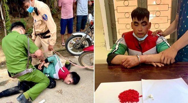 Cảnh sát giao thông quật ngã, bắt giữ đối tượng vận chuyển hàng trăm viên ma túy tổng hợp ảnh 1