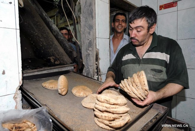 Dân Syria sống bình thản, bất chấp chiến tranh cận kề ảnh 1